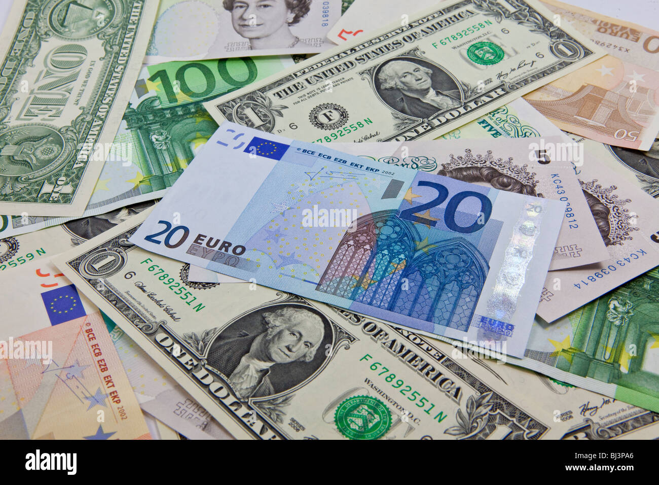 A mixture of bank notes, U.S. dollars, euros and British pounds - Stock Image