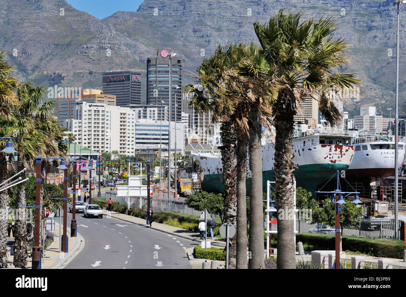 Ships in dry dock, high-rise buildings in front of the Table Mountain, Foreshore, Cape Town, Western Cape, South - Stock Image