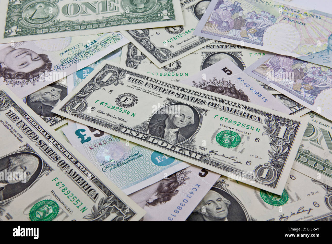 A mixture of bank notes, U.S. dollar and British pounds - Stock Image