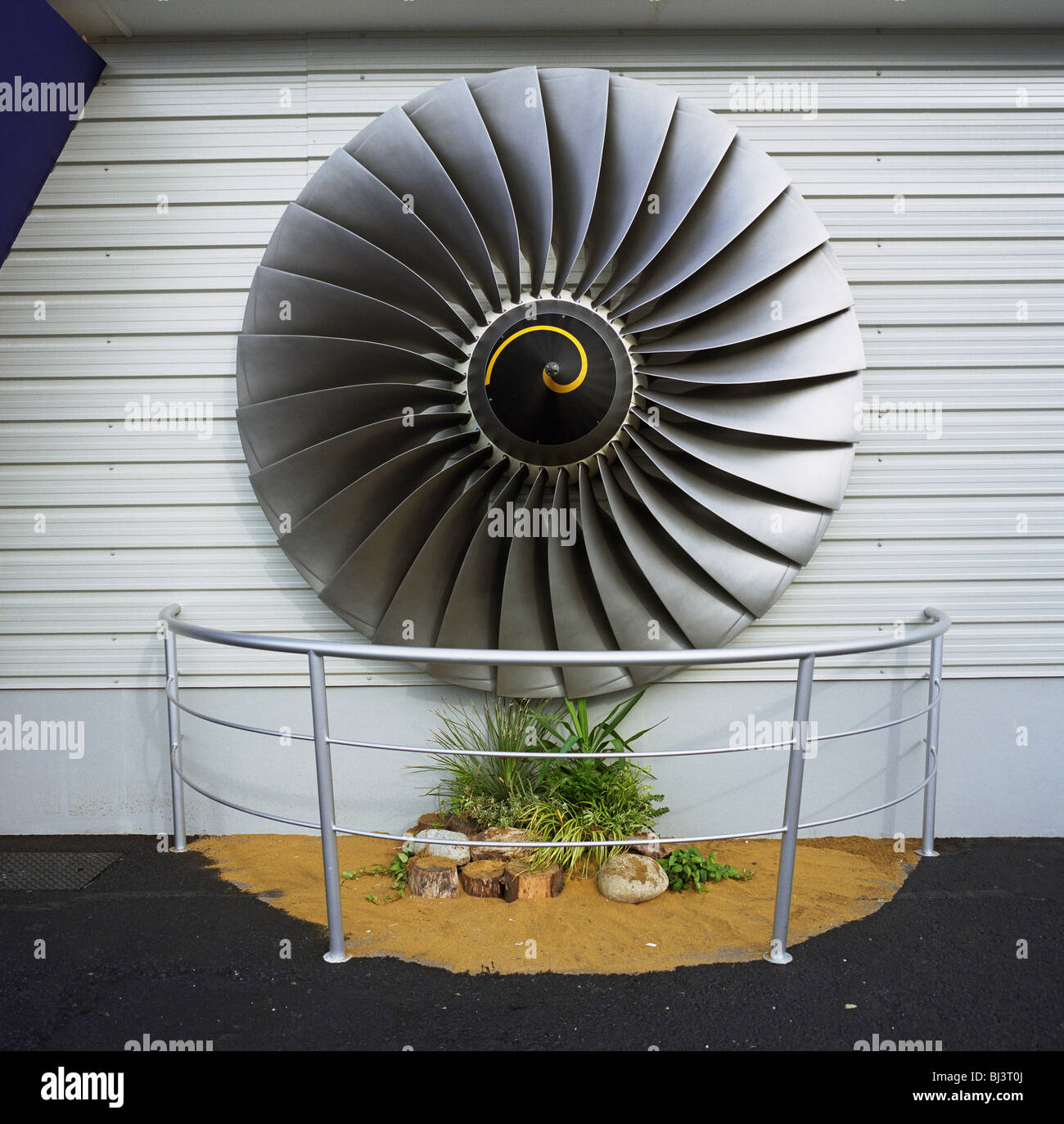 A Rolls-Royce turbofan has been fixed to the exterior of the company's sales stand at the Farnborough Air Show in - Stock Image
