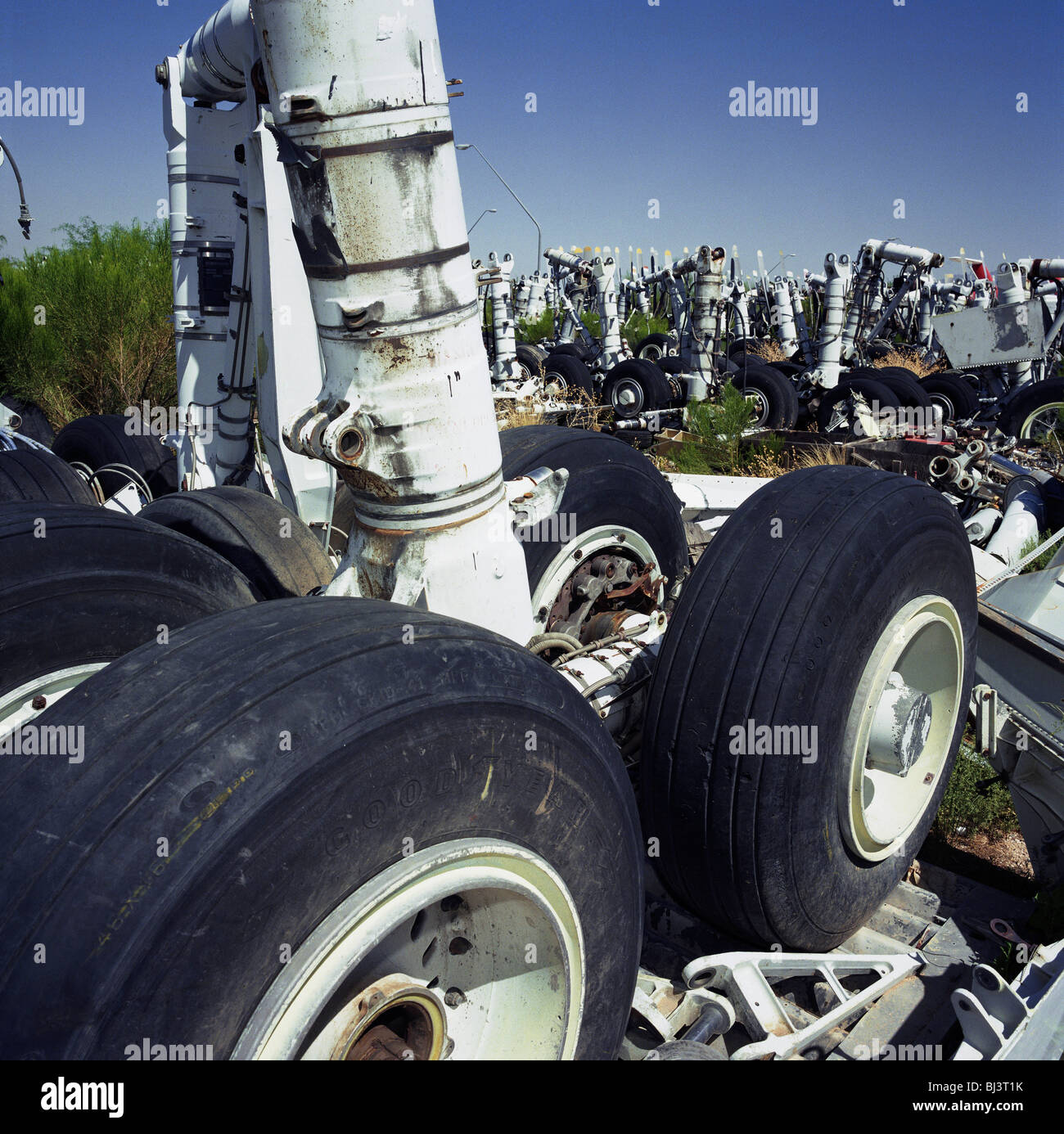Mid-day heat of arid Arizona desert, complete set of main landing gear undercarriage stands upright amid a field - Stock Image