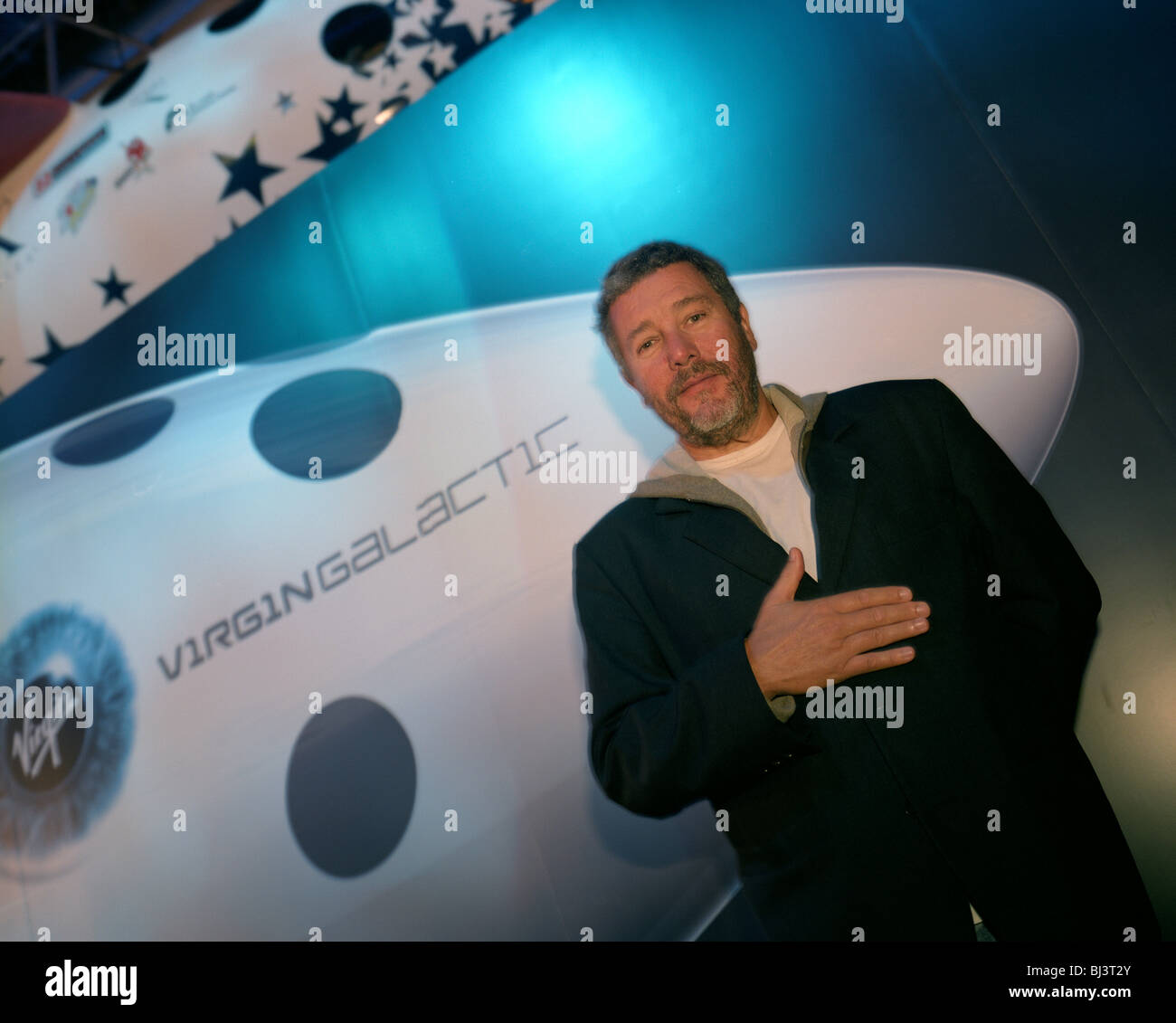 Designer Phillippe Starck standing at the nose of Virgin Galactic's SpaceShipTwo during its unveiling at NextFest. - Stock Image
