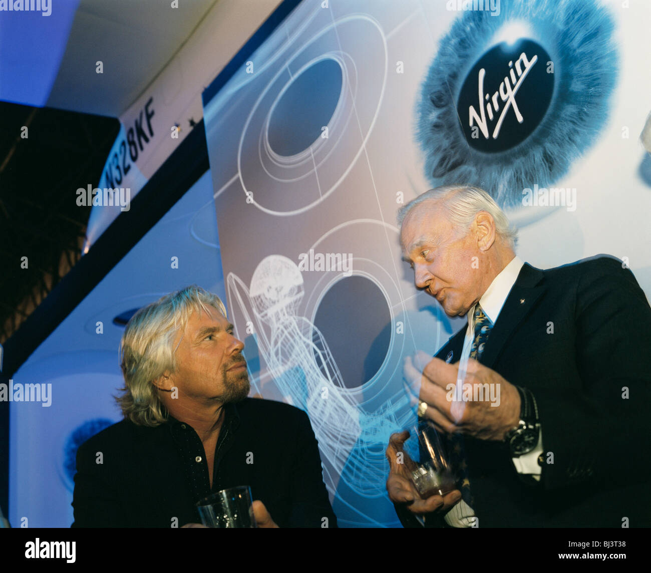 Virgin boss Sir Richard Branson and former Apollo (11) astronaut Buzz Aldrin chat by Virgin Galactic's SpaceShipTwo - Stock Image