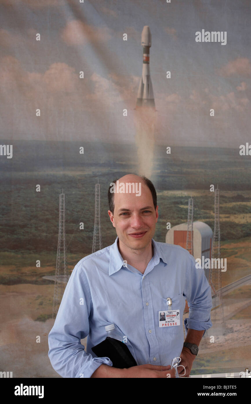 The writer, essayist and philosopher Alain de Botton stands in front of a mural of a Soyuz rocket. - Stock Image