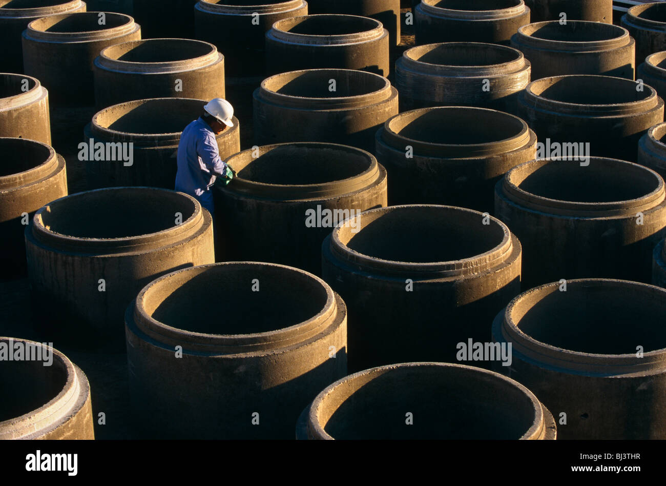Precast concrete pipes are prepared for distribution by a