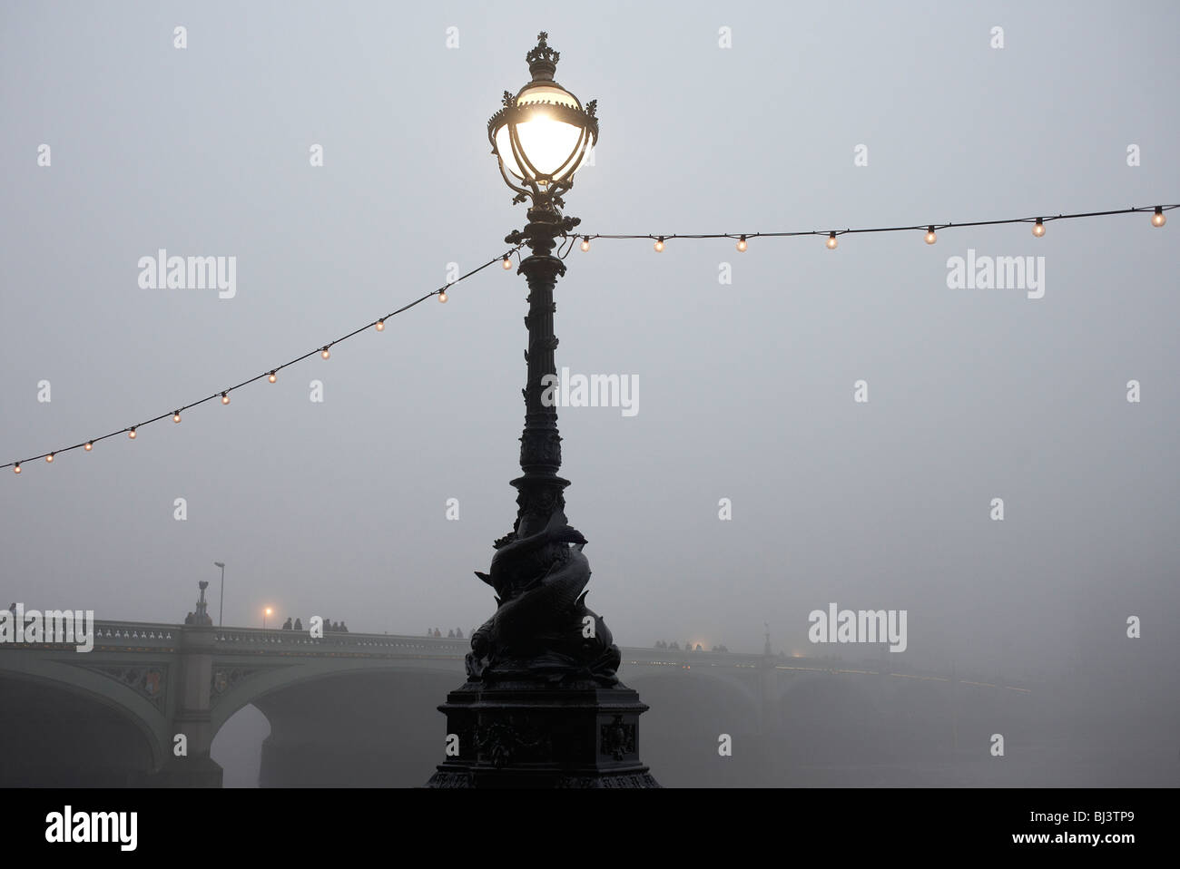 Early morning fog over the River Thames, the Embankment and Westminster Bridge from the southbank - Stock Image