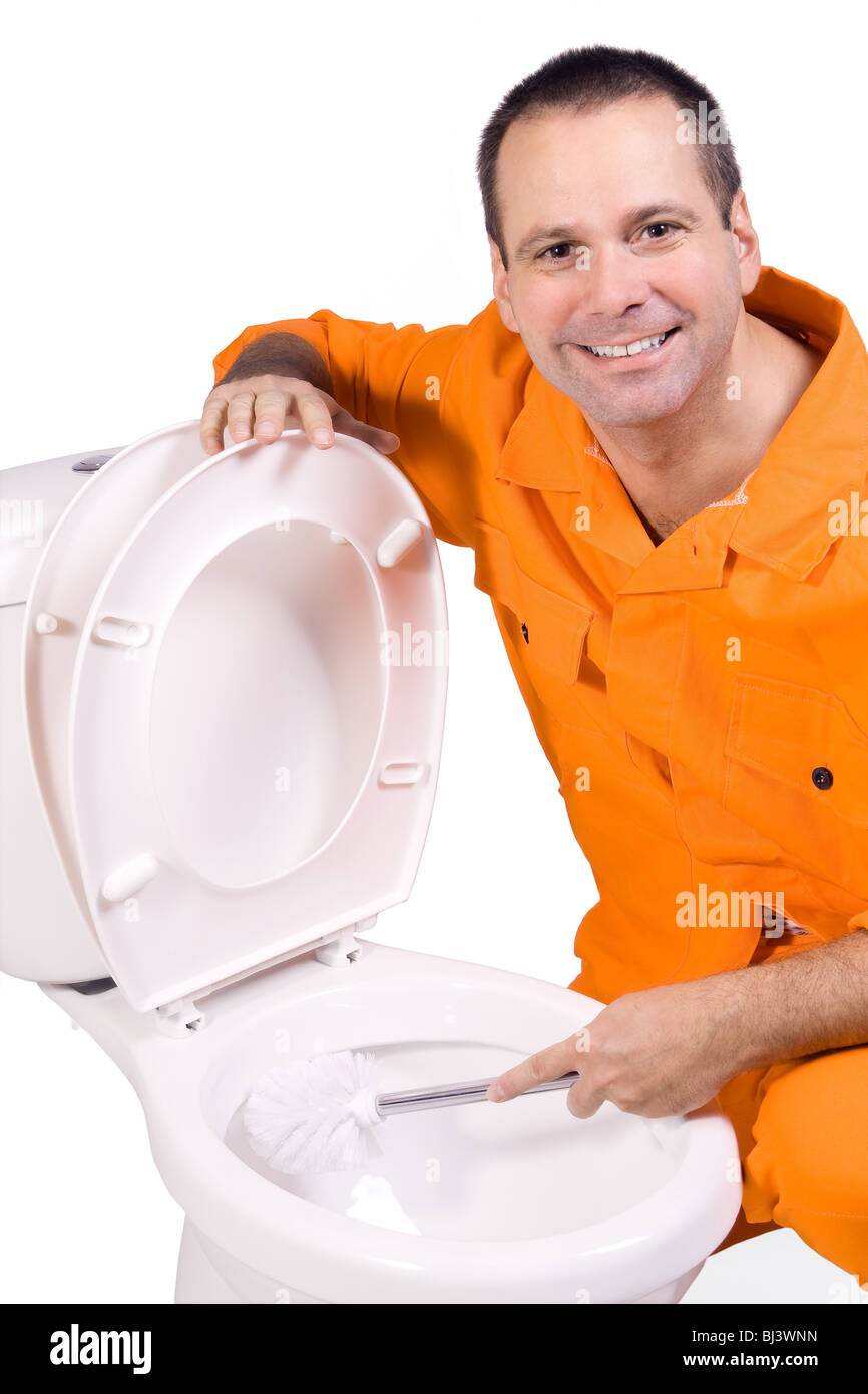 plumber clears toilet bowl Stock Photo: 28360241 - Alamy
