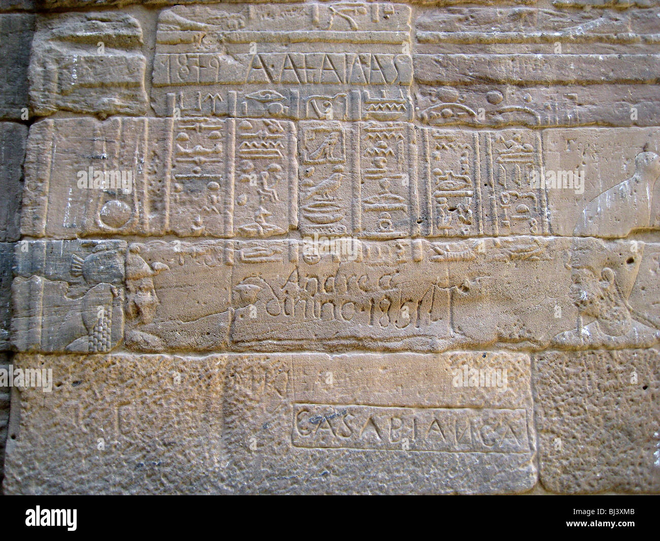 Hieroglyphic inscription on a wall of the Temple of Isis, defaced by graffiti, Philae, Egypt. Artist: Werner Forman - Stock Image