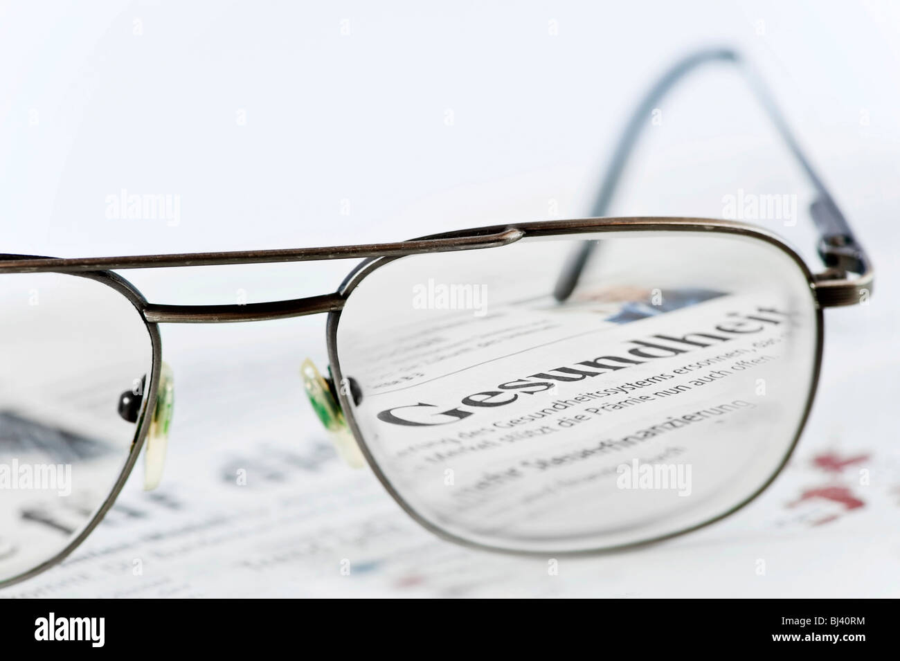 The headline Gesundheit, health seen through glasses - Stock Image