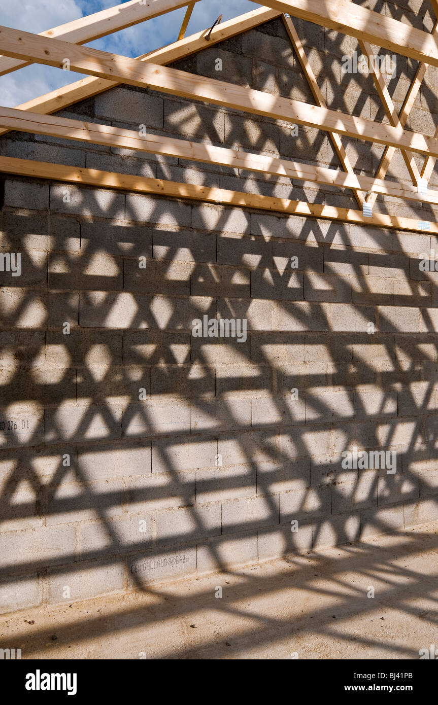 Prefabricated timber roof trusses on building site - France. - Stock Image