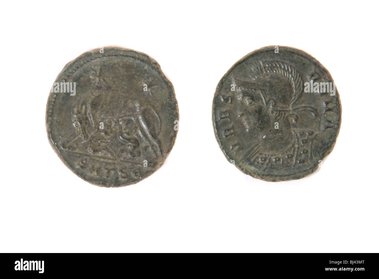 The back and front of a Roman coin found in England of the Roman Emperor Constantine 307 - 337 AD - Stock Image