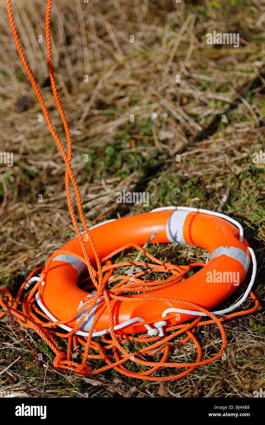 Irresponsible - A 'vandalised' Lifebuoy lies in a tangled heap. - Stock Image