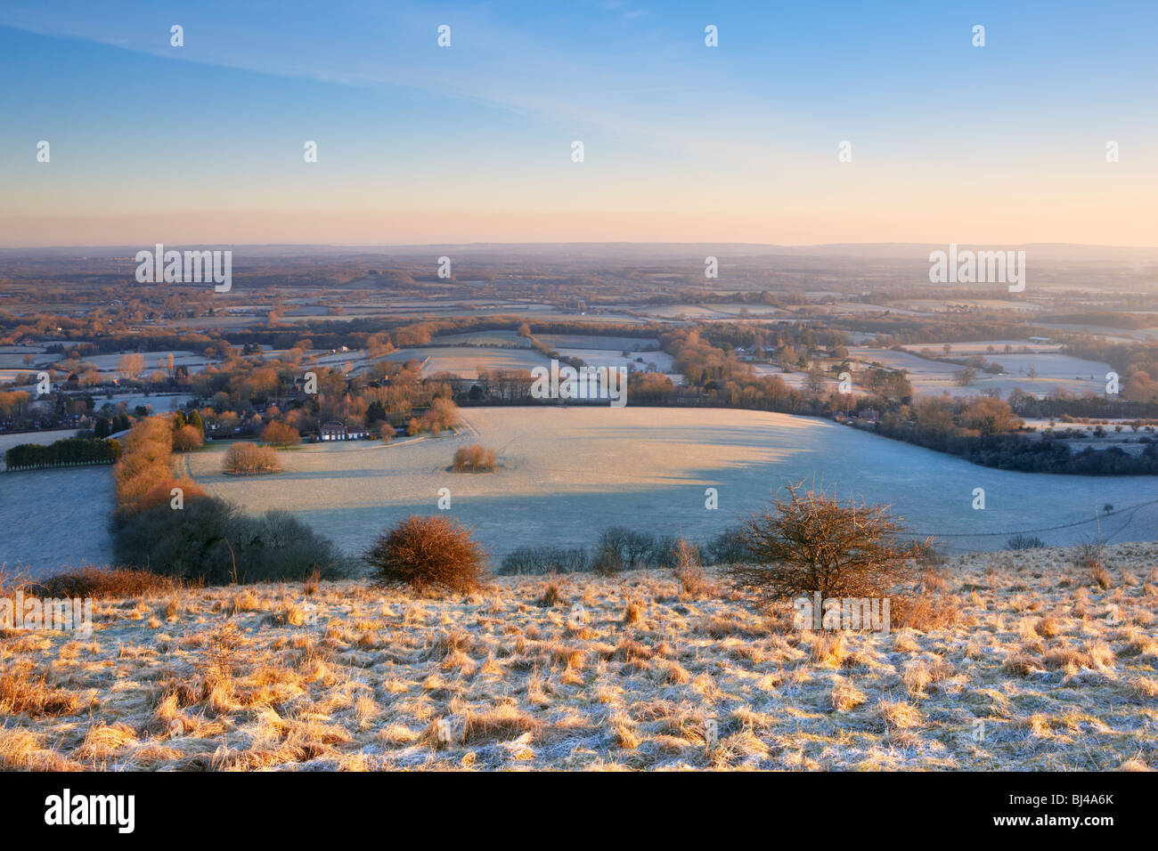 Looking northward on a frosty spring morning from the summit of Ditchling Beacon South Downs - Stock Image