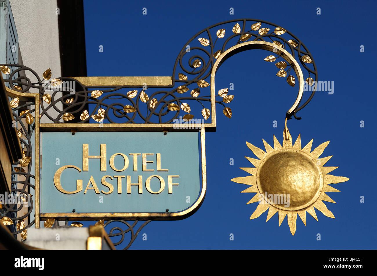 """Inn sign for the """"Hotel Gasthof Sonne"""" against the blue sky, Hauptstrasse 29, Ebermannstadt, Upper Franconia, Bavaria, Stock Photo"""