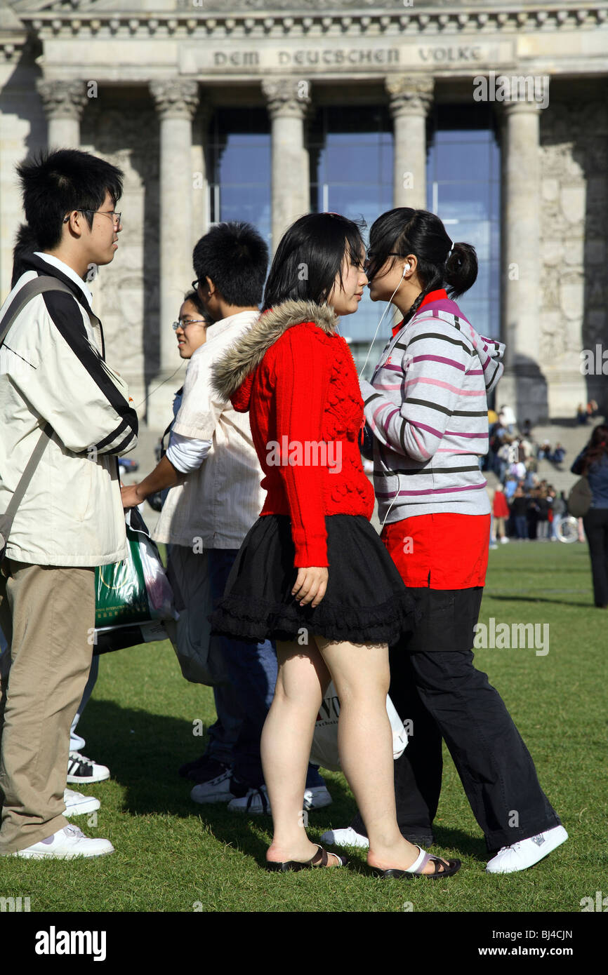 Young Asian tourists in front of the Reichstag, Berlin, Germany Stock Photo