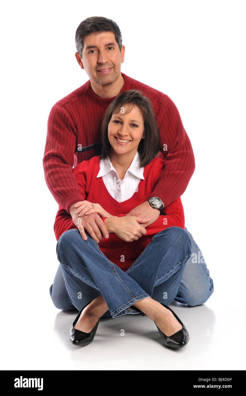 Middle age couple smiling isolated on a white background - Stock Image
