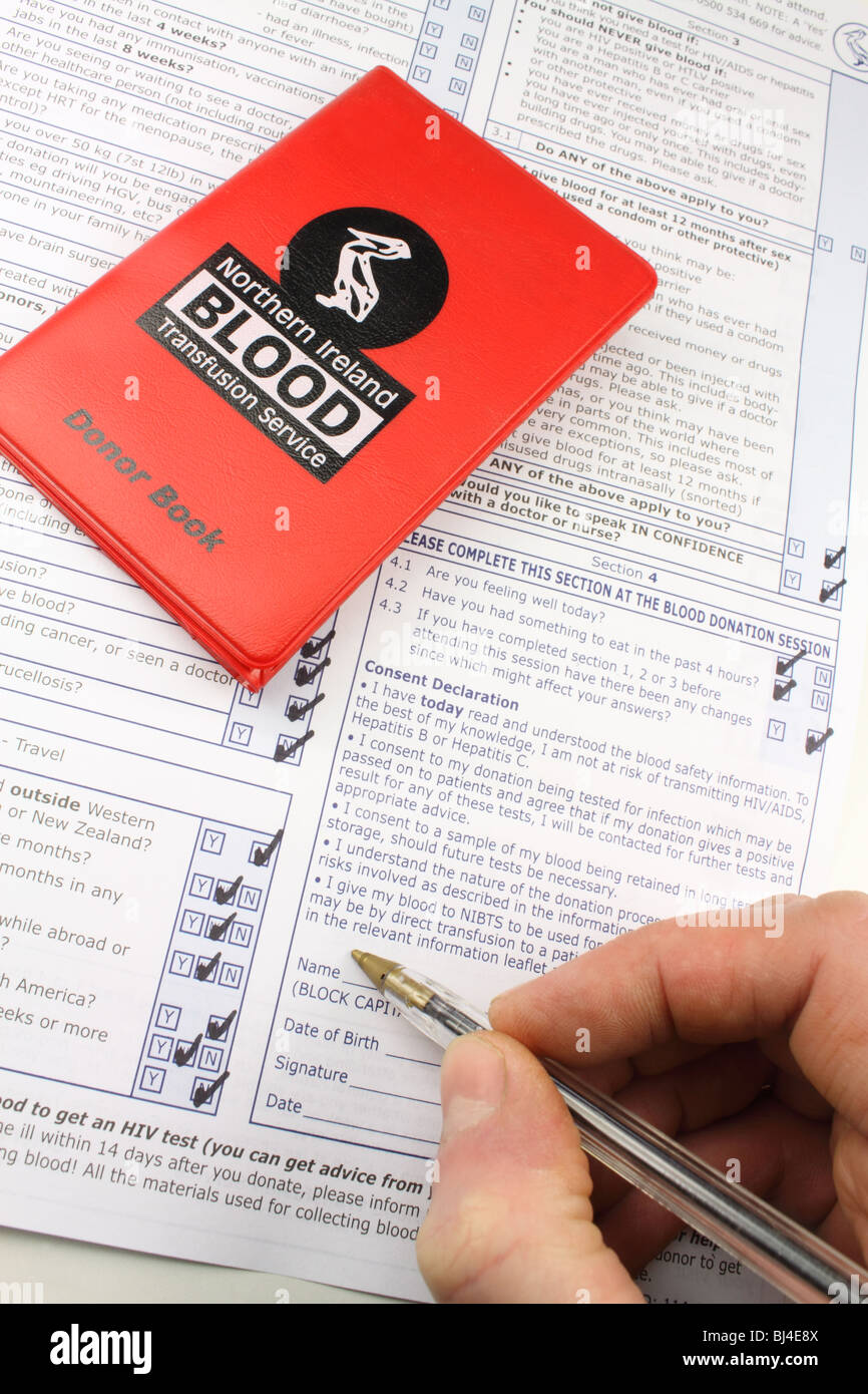 Completing a consent form for the blood transfusion service - Stock Image