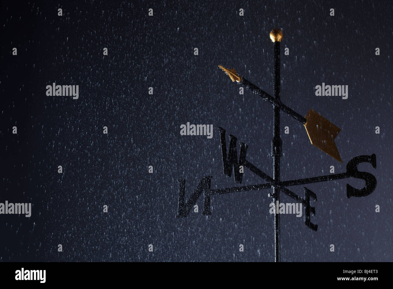 Weather Vane in Rain - Stock Image