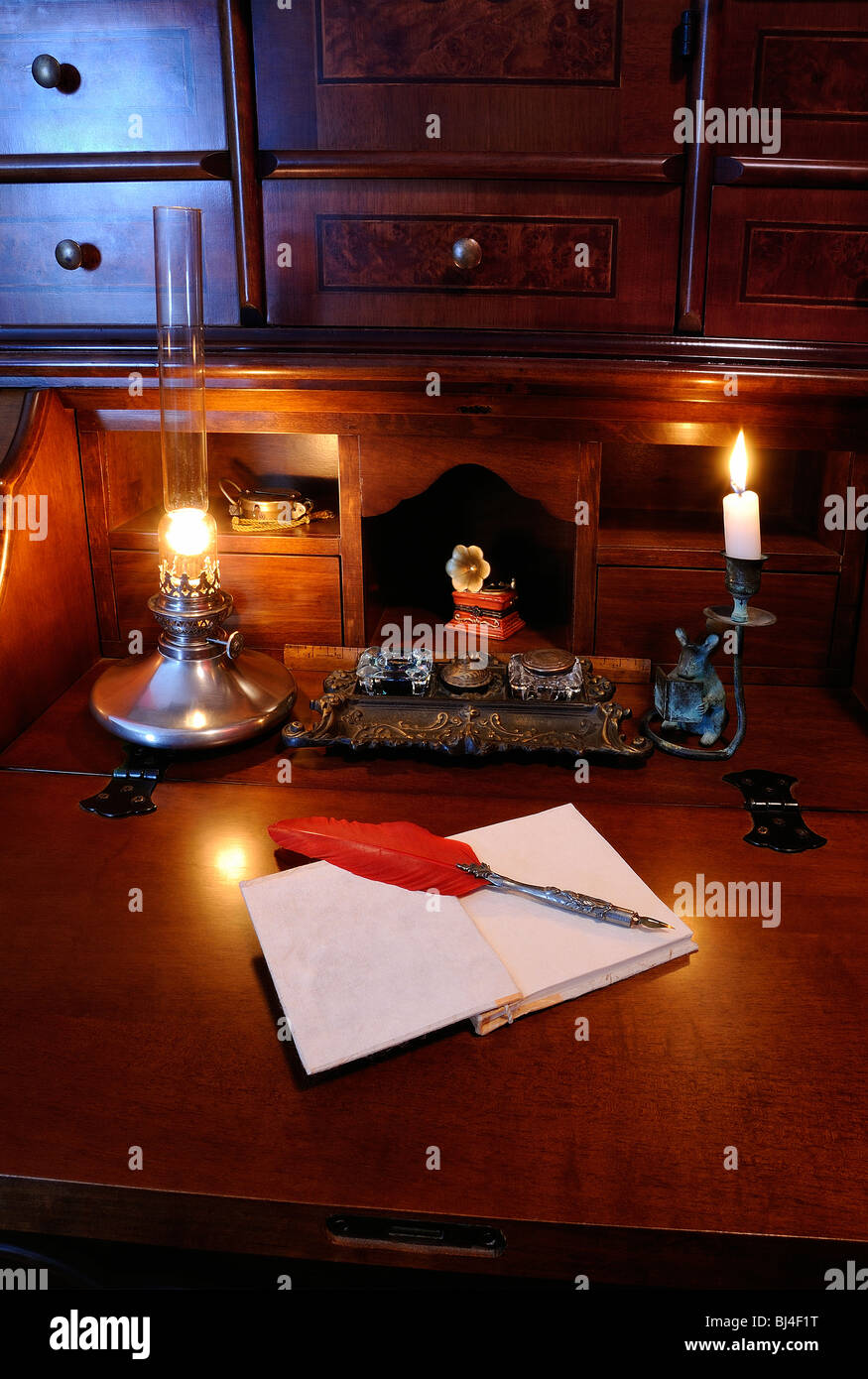 Antique writing desk with red feather quill pen and oil lamp stock antique writing desk with red feather quill pen and oil lamp aloadofball Choice Image