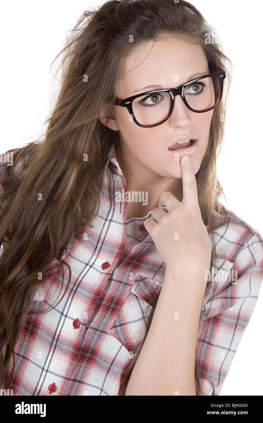Shot of a Confused Teenager Geek against White Background - Stock Image