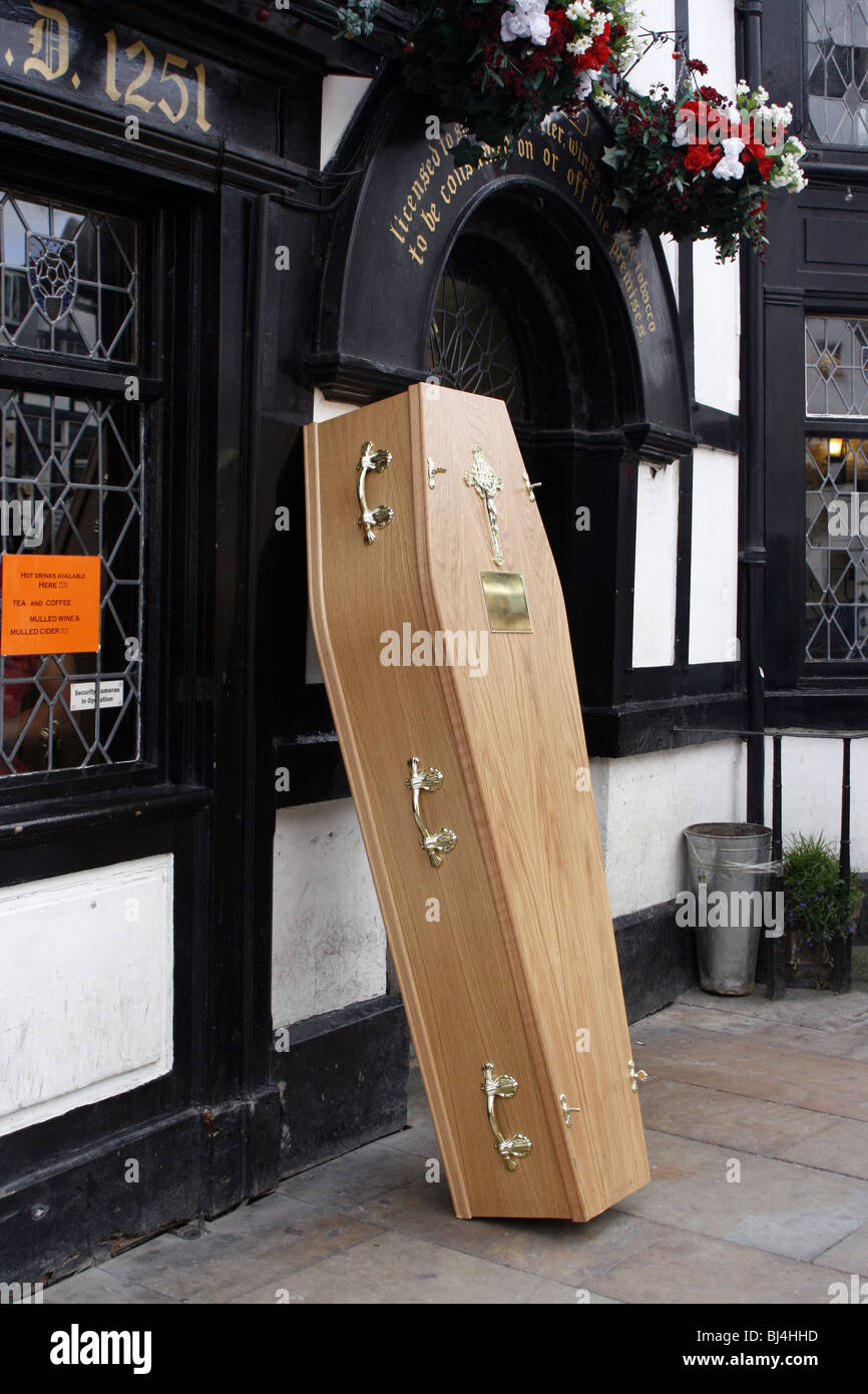 Coffin outside an English pub in the UK - Stock Image