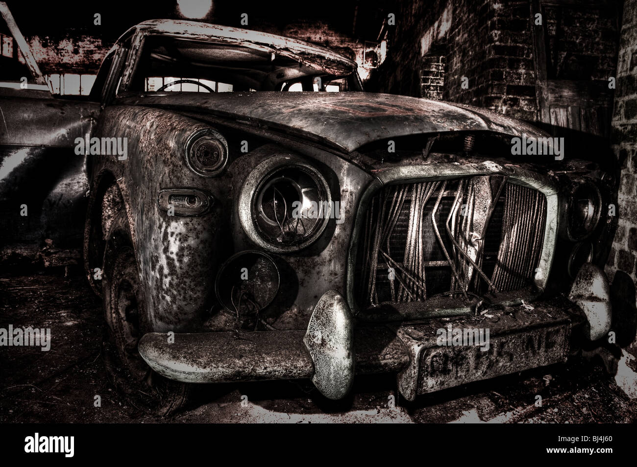 Abandoned old car in a derelict air base - Stock Image