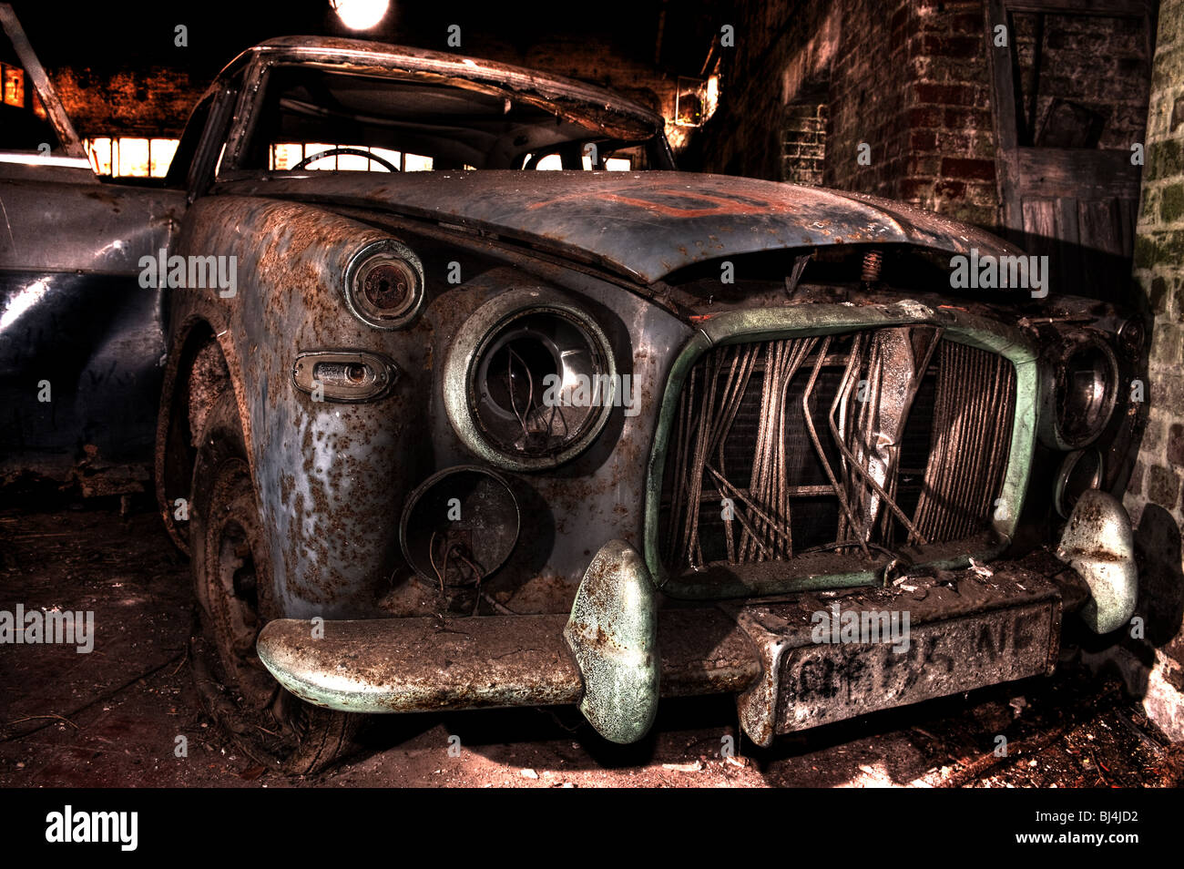 Abandoned old car in a derelict air base in croft warrington cheshire england - Stock Image