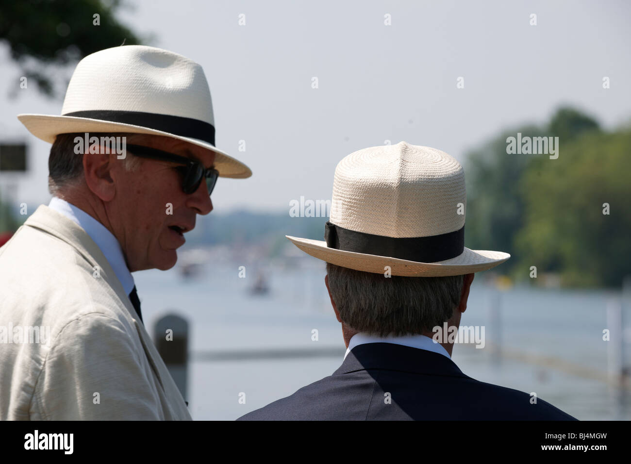 Spectators on river bank at Henley Regatta with Panama hats - Stock Image