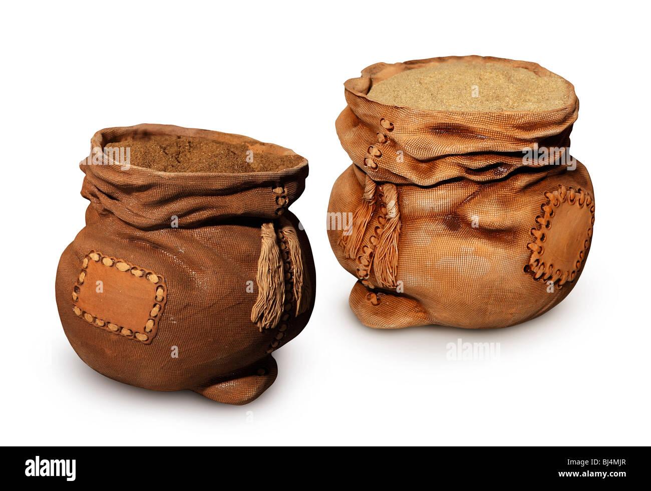 Decorative ceramic sacks full of dark and light meal isolated on white background - Stock Image