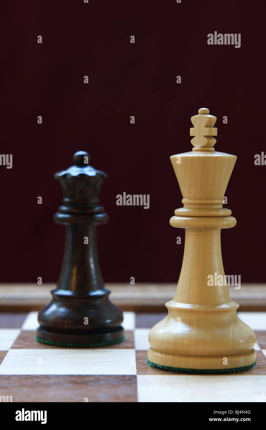 Chess Queen threatens King - Stock Image