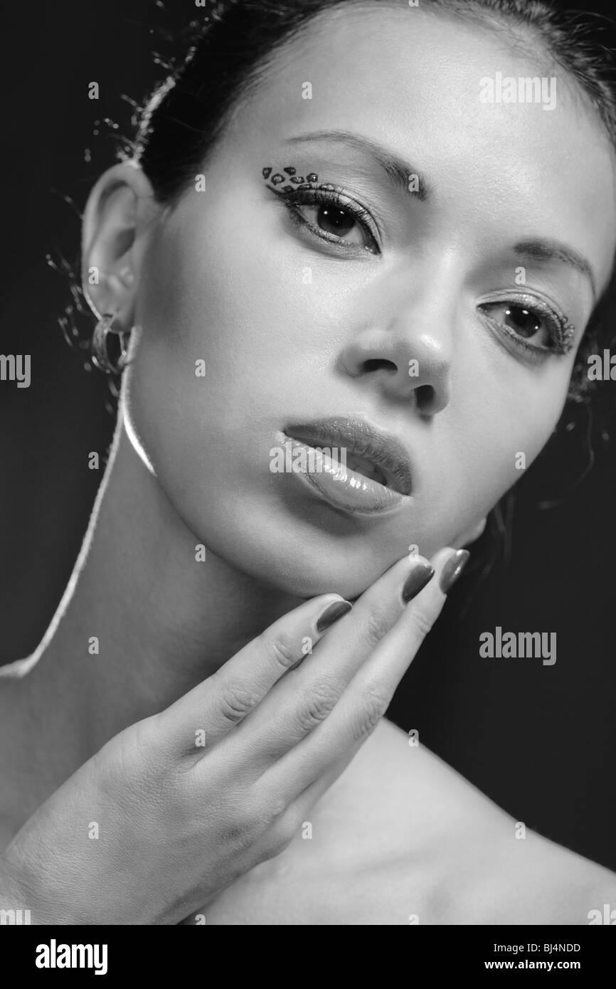 Young woman studio fashion portrait. Black and white. - Stock Image