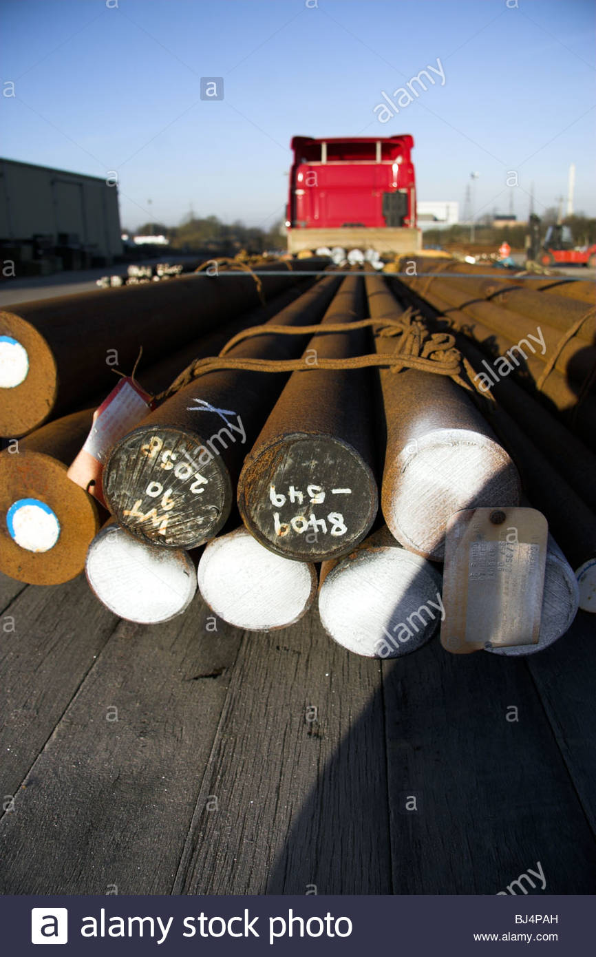 A load of hot rolled round carbon steel on the back of a lorry trailer. UK. Stock Photo