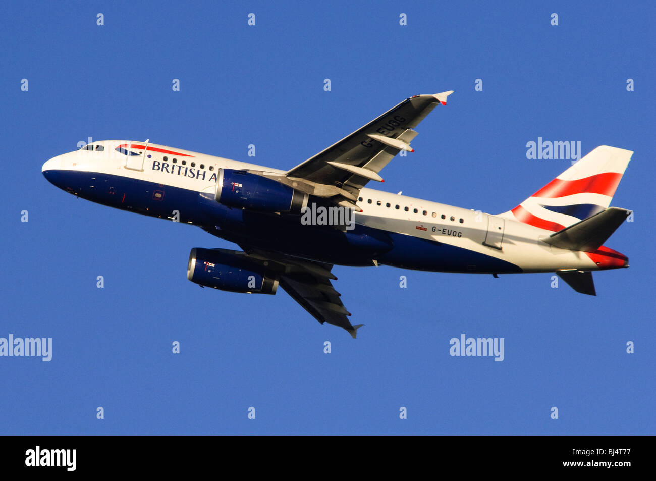 Airbus A319 operated by British Airways climbing out from take off at London Heathrow Airport - Stock Image