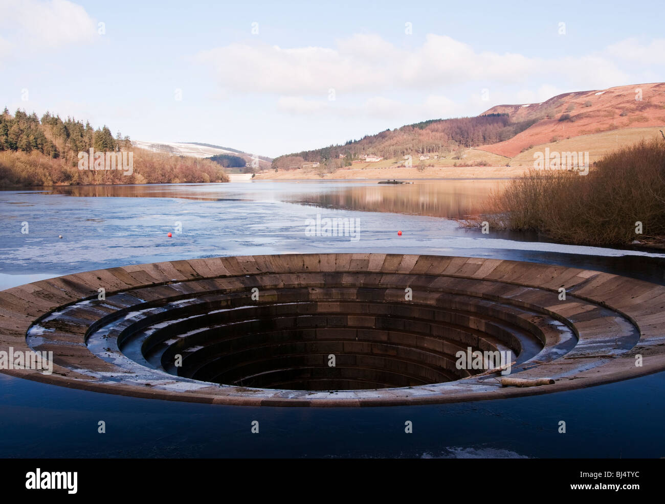 The overflow at Ladybower Reservoir in the Peak District National Park, also known as the plug hole. - Stock Image