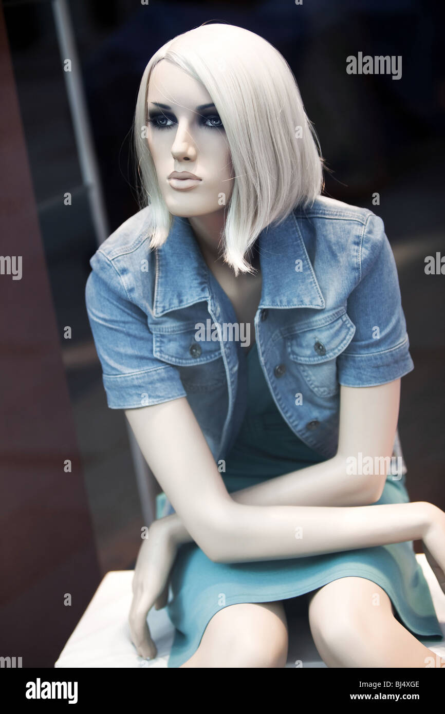 Beautiful mannequin in a shop window. - Stock Image
