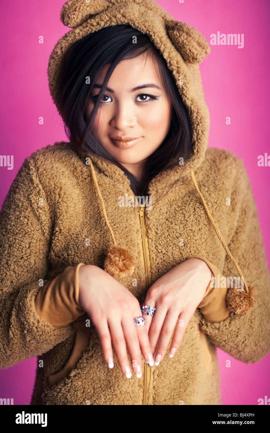 https://c8.alamy.com/comp/BJ4XPH/young-japan-woman-in-bear-suit-sweet-portrait-BJ4XPH.jpg