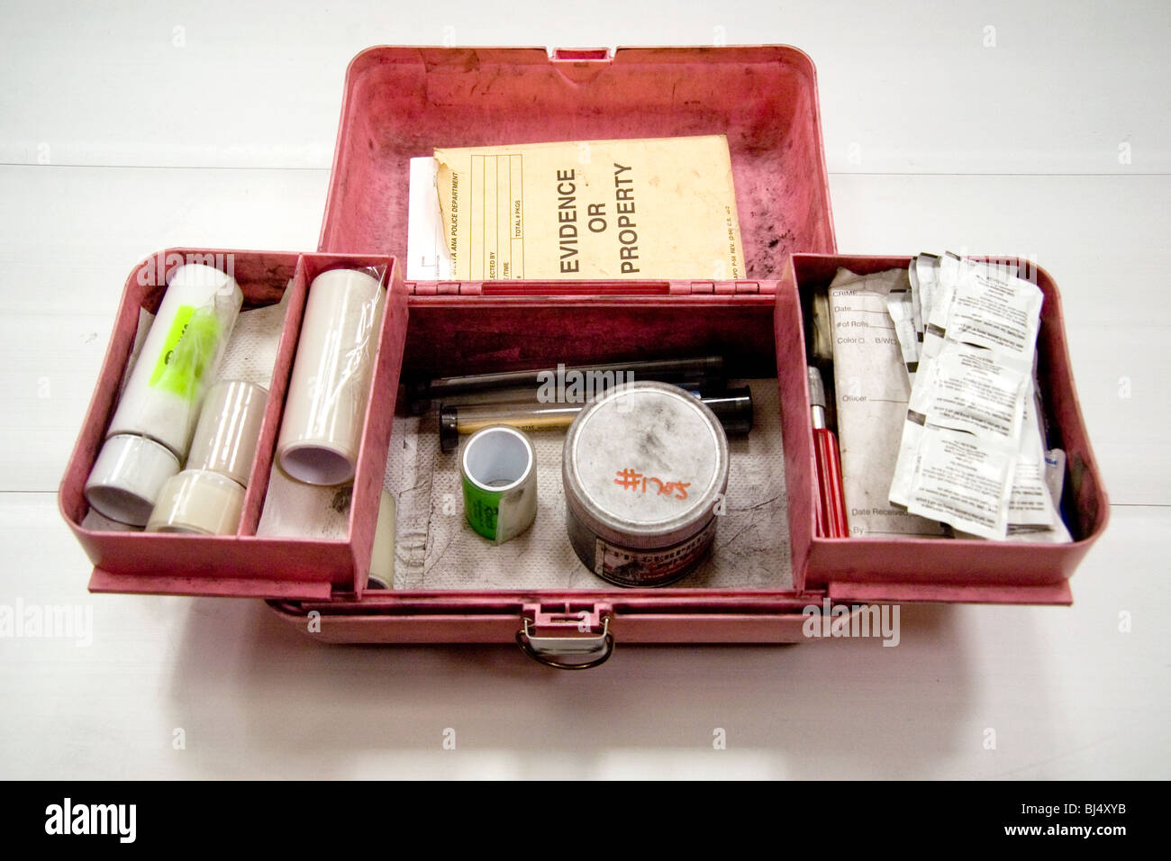 Equipped with powder, brushes, lifting tapes, evidence book and cleanups, a police fingerprint kit is ready for - Stock Image