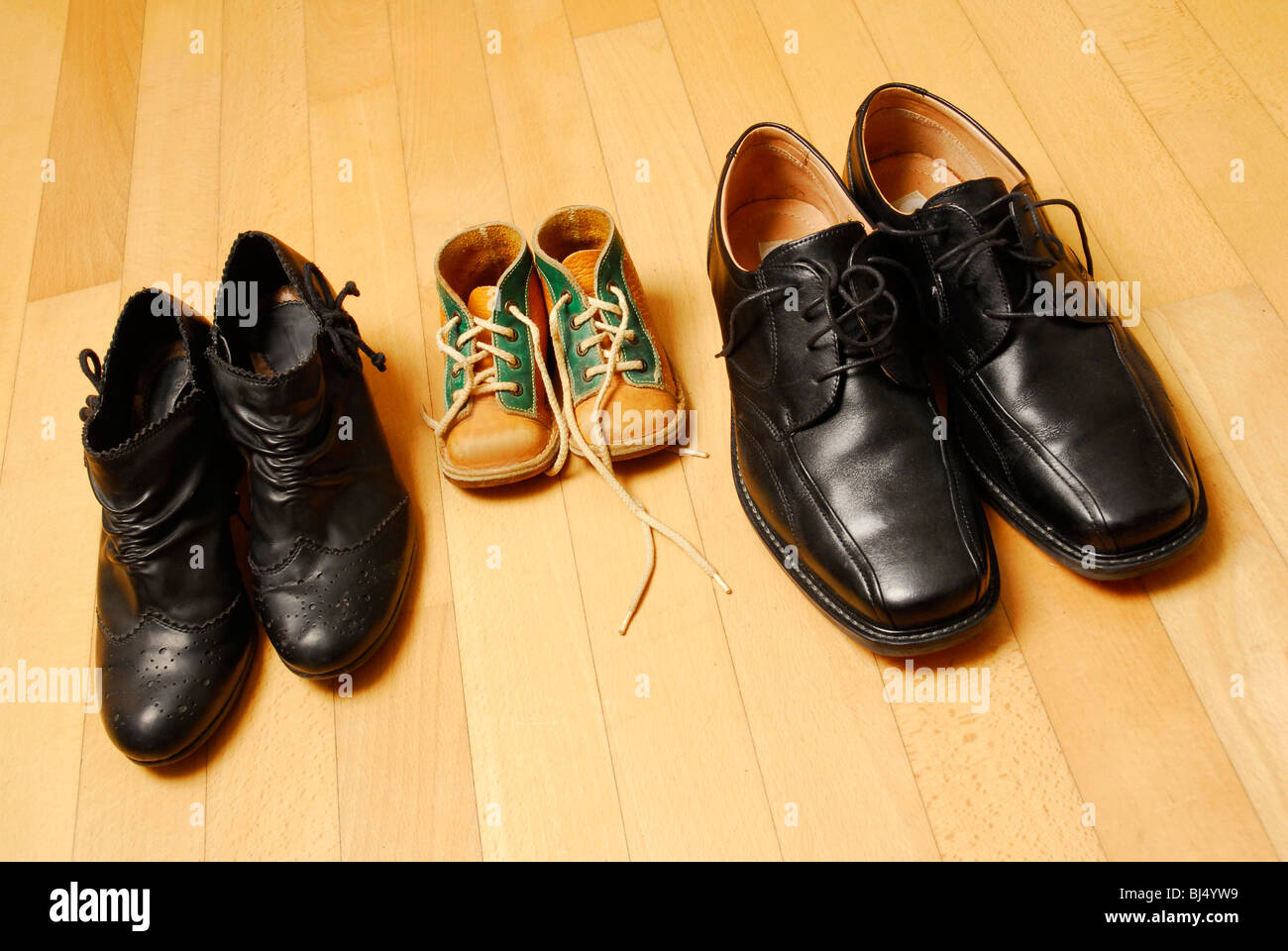 Shoes of a family, symbolic image for family - Stock Image
