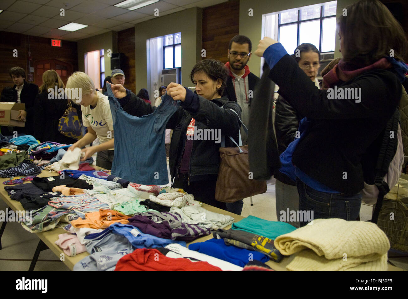Thrifty shoppers at a free Stop 'N' Swap event in the Jackson Heights neighborhood of Queens in NY - Stock Image