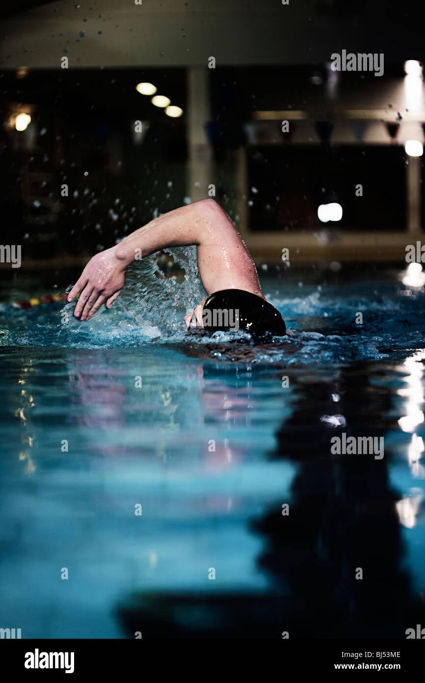 Man in Pool - Stock Image