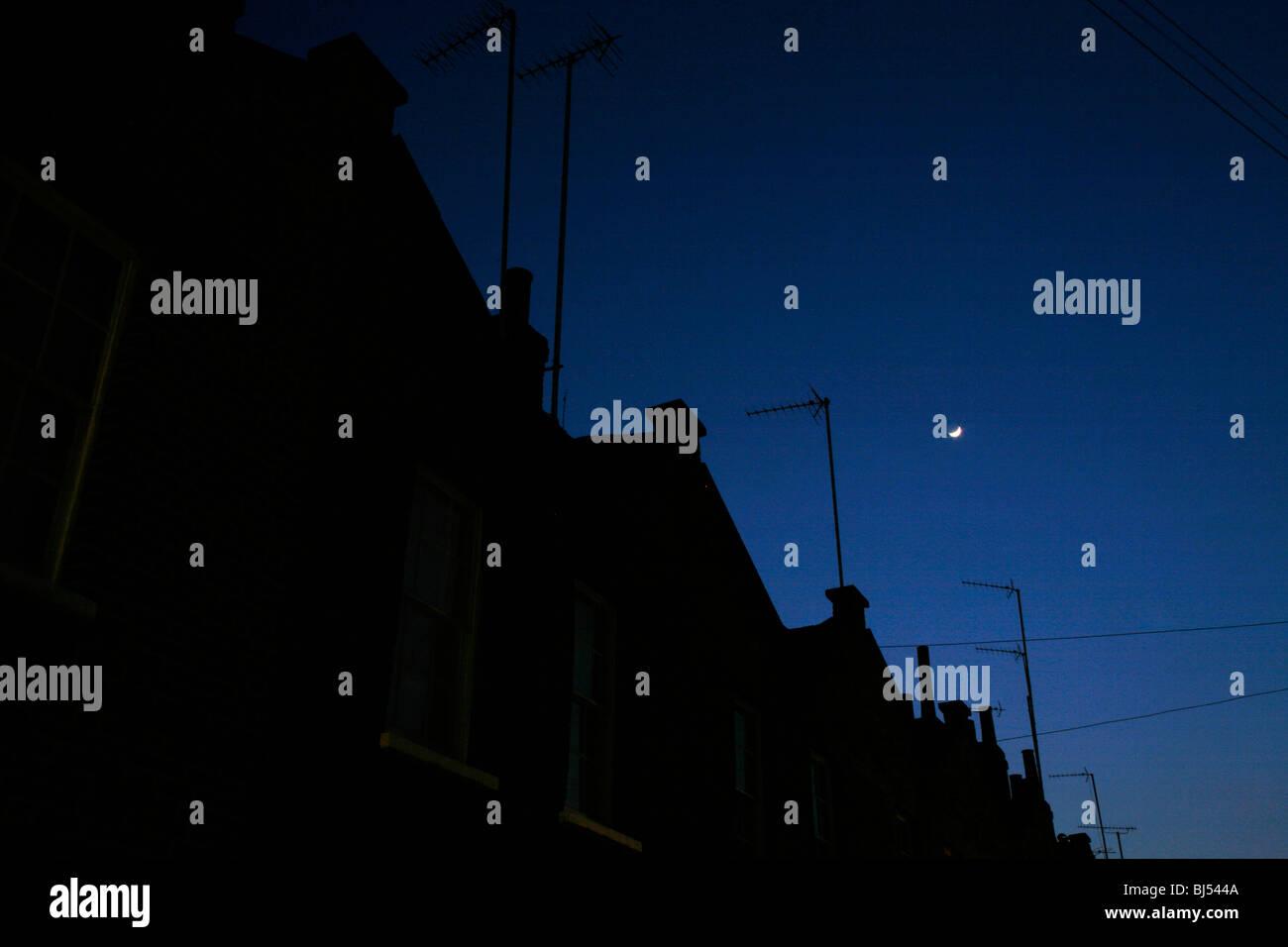 Crescent moon shining above Roupell Street, Waterloo, London, UK - Stock Image