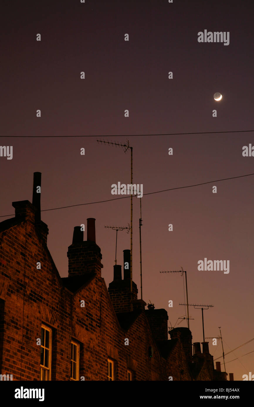 Crescent moon shining above Roupell Street, Waterloo, London, UK - Stock Image