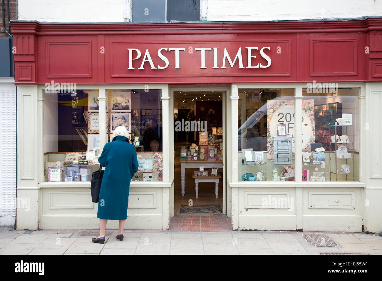 Past Times shop exterior Colchester Essex England, woman looking in wondow - Stock Image