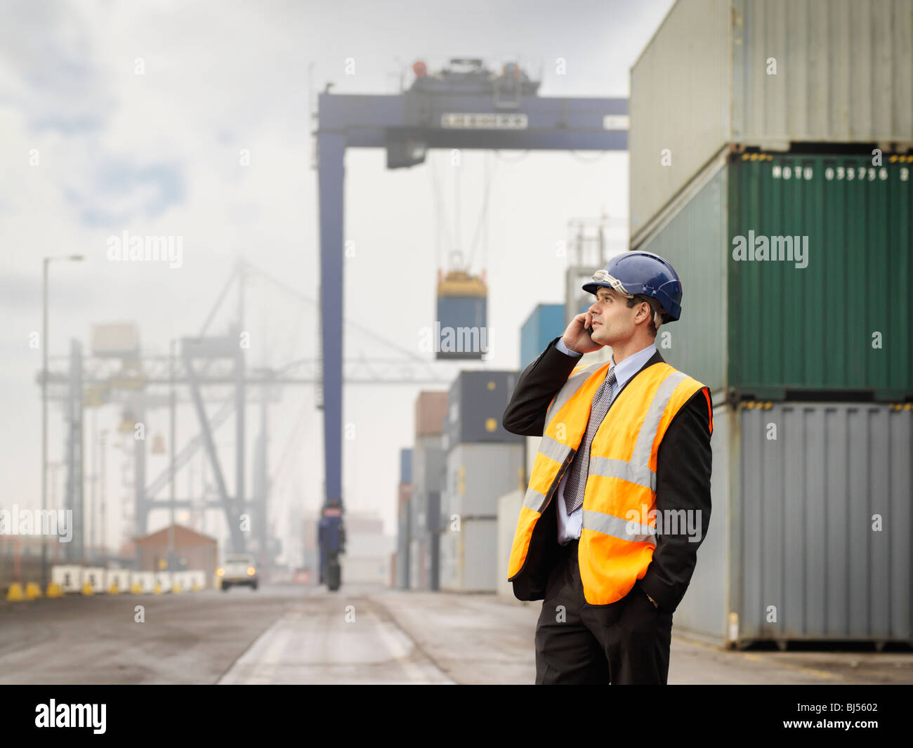 Businessman In Port With Containers Stock Photo