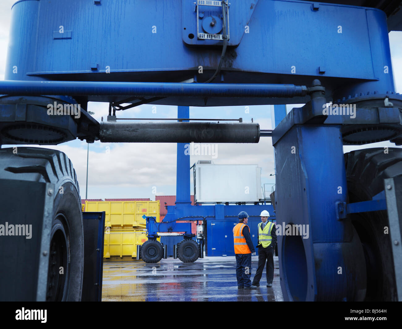 Port Workers In Container Port - Stock Image