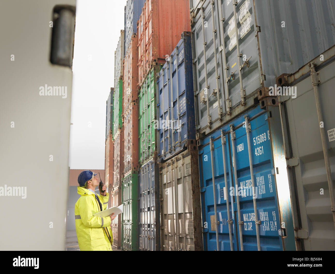 Port Worker With Shipping Container - Stock Image