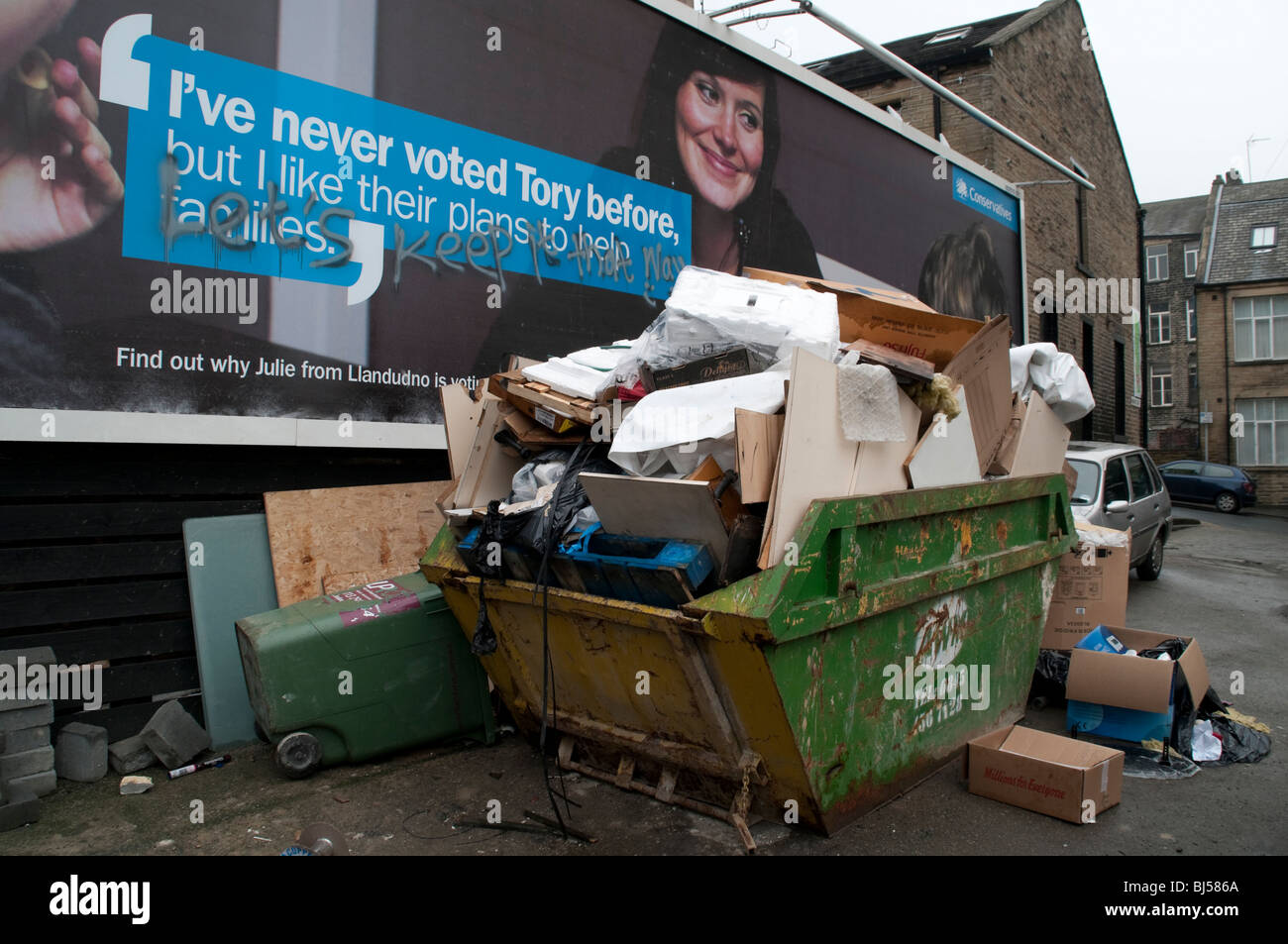 Tory election poster with graffiti, strap line reads 'I've never voted tory before,' graffiti reads - Stock Image