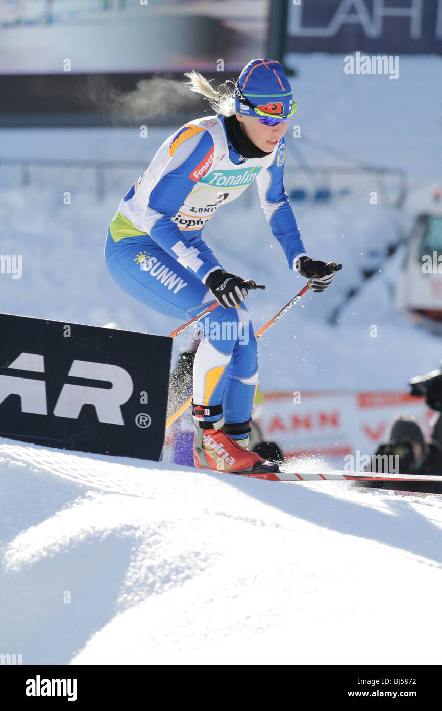 Riikka Sarasoja of Finland competes during the FIS World Cup Cross Country, Ladies 4 x 5 km Classic/Free Relay in - Stock Image