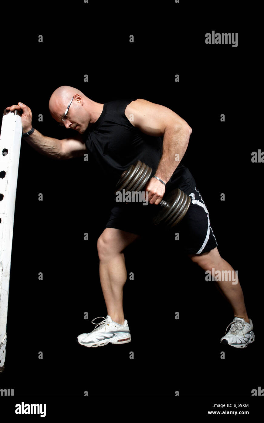 bodybuilder lifting dumbbell - Stock Image