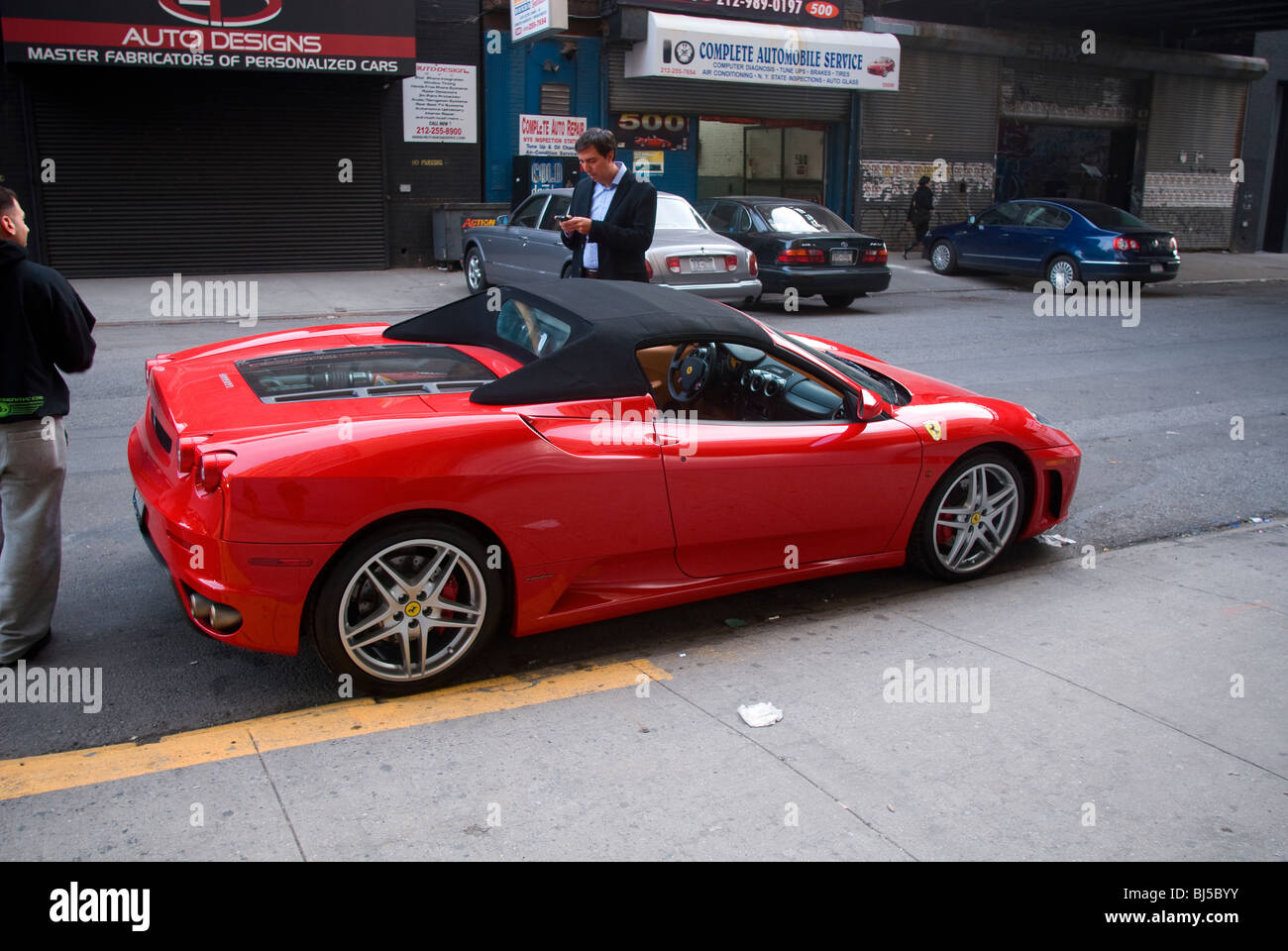 A Tesla Roadster outside the Tesla Motors showroom in the trendy gallery district of West Chelsea in New York - Stock Image